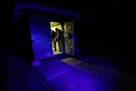 Rangers go into a radio room while patrolling Ol Pejeta Conservancy.